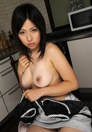 Randy brunette Oriental bares breasts but man comes feeling them up inn kitchen