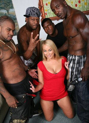Strong black stallions cover blonde MILF's face with sperm after group fuck