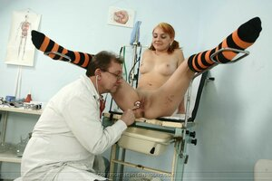 Glorious redhead has holes filled with doctor's cock being felt up by him