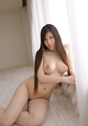 Nude Japanese hottie gladly demonstrates impressive natural melons on cam
