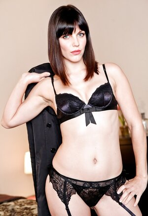 Hot adult star wears nothing under coat but black underwear and stockings