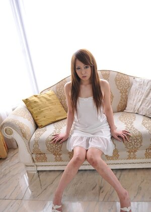 Cute broad from Japan in white dress prefers to sit on white couch