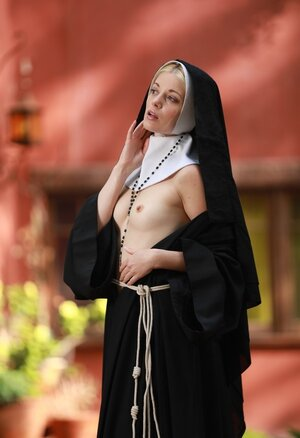 Slim blonde nun provocatively shows tiny tits and cunny hidden under outfit