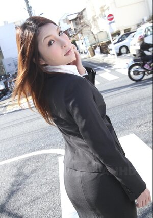 Sweet Japanese secretary seductively poses while going at her work