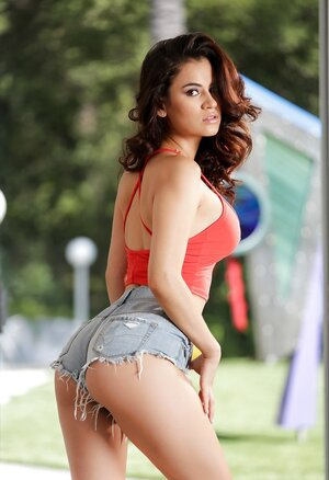 Lads won't mind if babe shows what she hides under red top and sexy denim shorts