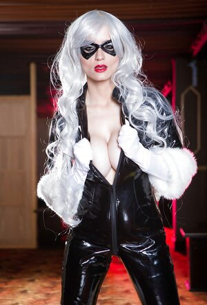 Superheroine is in mood to relax with no latex costume on her immaculate body