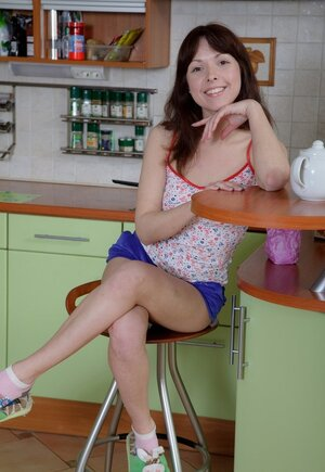 Enchanting 18-19 y.o. tempts her fella into spontaneous affair right in kitchen